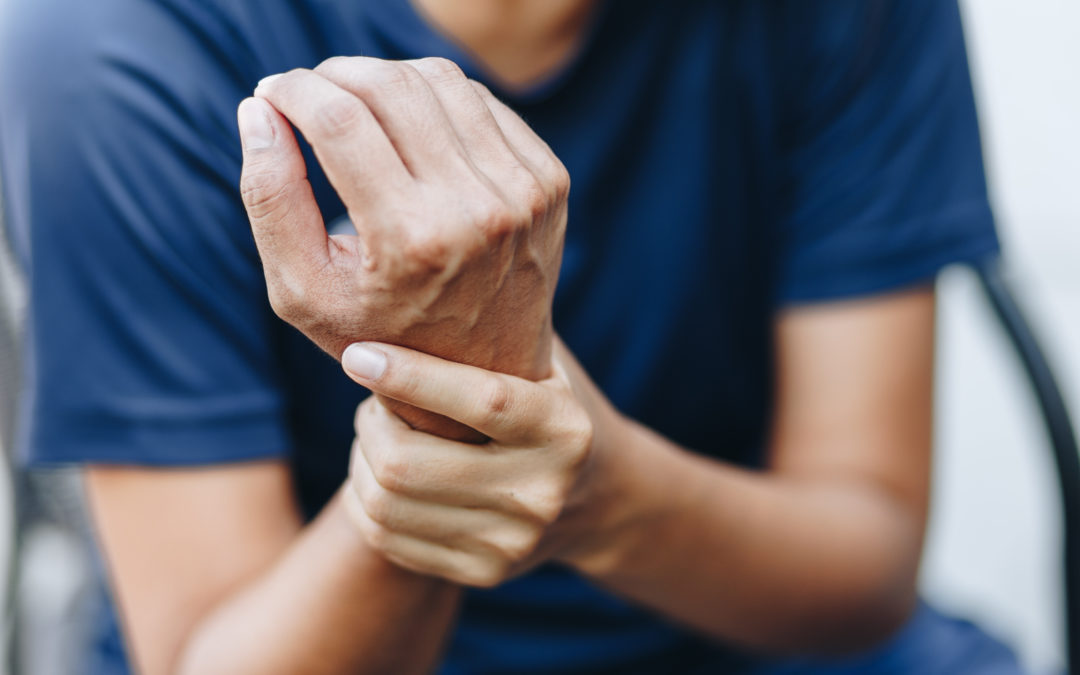 Person holding wrist from achy joints